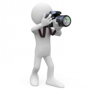 Man taking a picture with his SLR camera