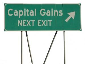 Green road sign capital gains